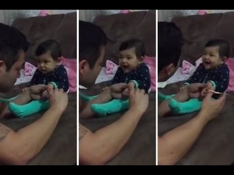 Cute Baby Pranks her Dad !