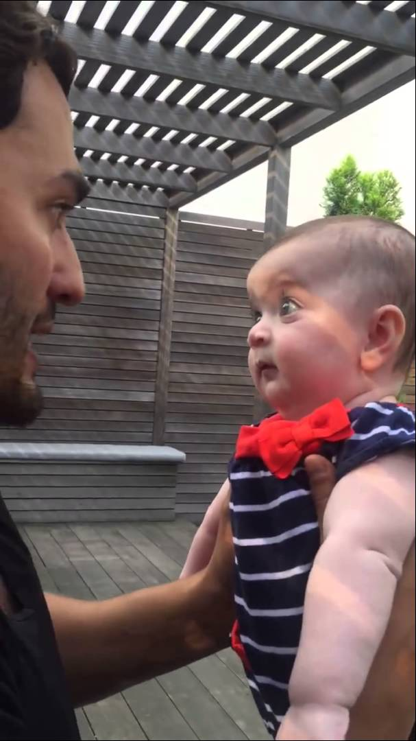 Cute baby is absolutely fascinated hearing her fathers tales on miracle of life…